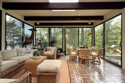 Sunroom in luxury home with patterned tile