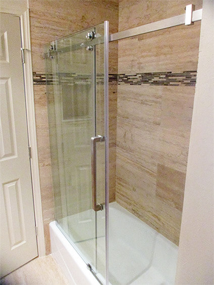 After: View of the frameless shower door with brushed nickel hardware