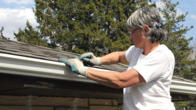 Sunroom Maintenance Tips - Woman Doing Roof Maintenance